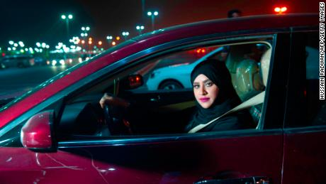 Saudi woman Sabika Habib drives her car through the streets of Khobar City on her way to Bahrain on Sunday.
