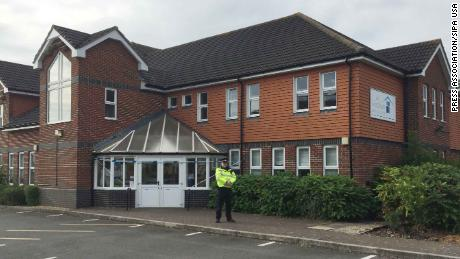 A police officer stands outside the Amesbury Baptist Church in Wiltshire.
