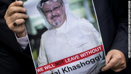 A man holds a poster of Khashoggi during a protest at the entrance to Saudi Arabia's consulate in Istanbul on October 8.